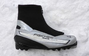 "Fischer Touring Classic Cross-Country Ski Boot. A very basic ""touring"" or classic cross-country ski boot. There's nothing wrong with this boot, but it's definitely not nearly as lightweight or made with the same high quality materials as the carbon lite racing-oriented classic boot. © Jared Manninen"