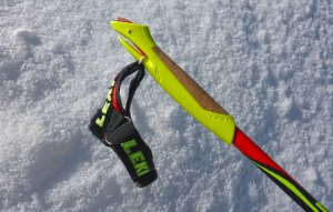 Leki and other manufacturers, make higher-end cross-country ski poles that feature a quick release strap and handle system. On this model, you press the red button at the top of the handle and it will draw back the red wedge (in the slot) back so that the strap can be removed completely from the handle. © Jared Manninen