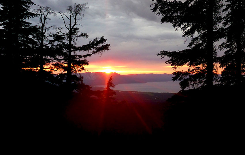 Red sunset over Lake Tahoe with silhouetted trees