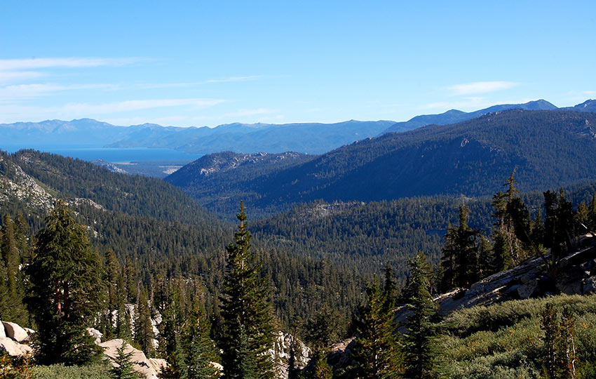 Looking across the forest and mountains to see Lake Tahoe