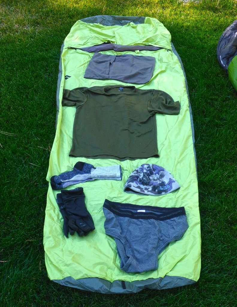 Backpacking clothing displayed on top of an ultra-lite bivy sack