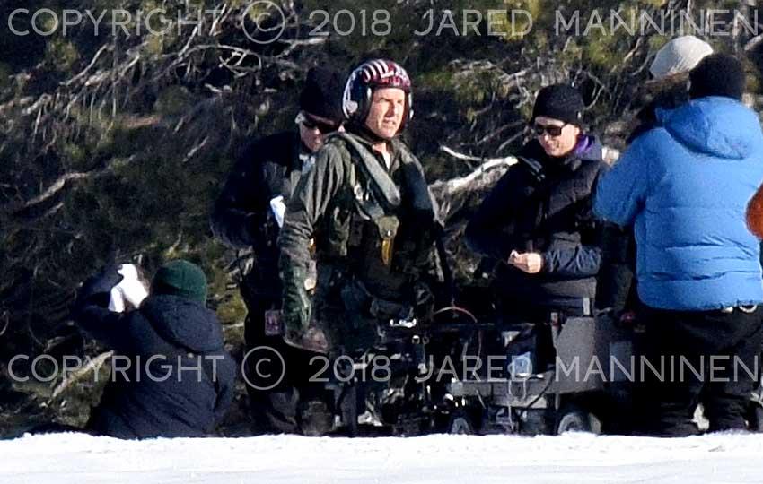 Tom Cruise looks toward the sun as he waits between scenes while filming Top Gun: Maverick