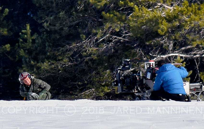 Tom Cruise takes a knee to release himself from his parachute harness while filming Top Gun: Maverick