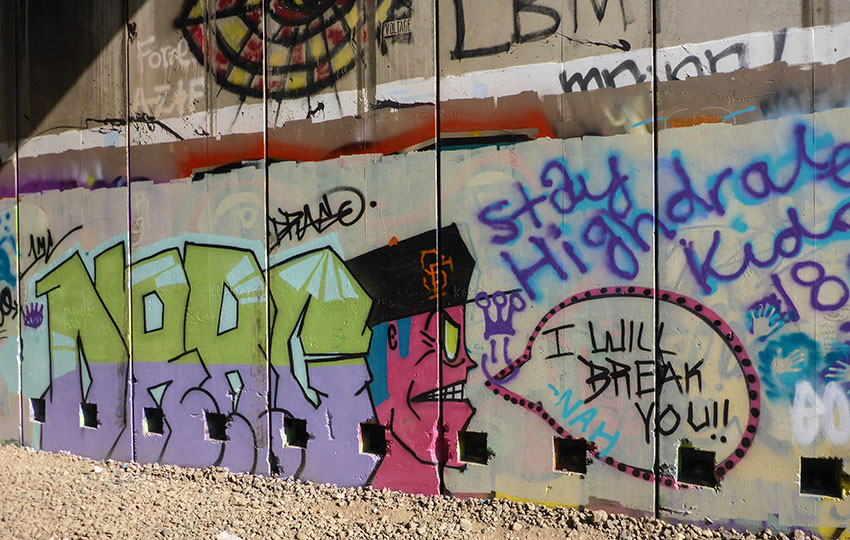 This series of graffiti art was on the last aspect of the north wall at the very end of the two miles of tunnels that I hiked on November 10, 2018. Most likely, this specific art has been painted over with new art. © Jared Manninen
