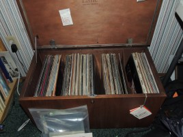 Lane chest open, mostly full of LP's