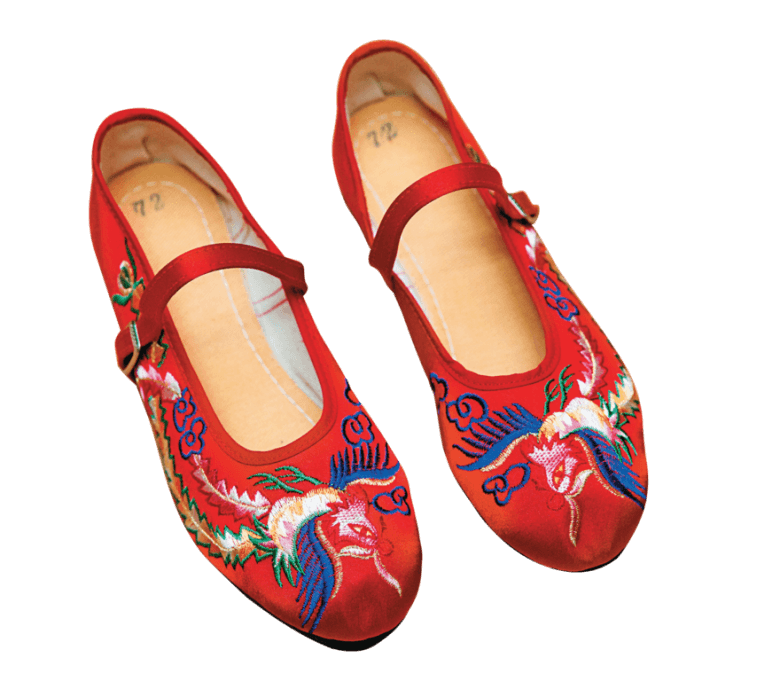 The red embroidered shoes represent luck are one of the best sellers in the shop.