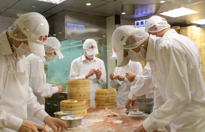 Din Tai Fung dumpling masters making Xiao Long Bao.