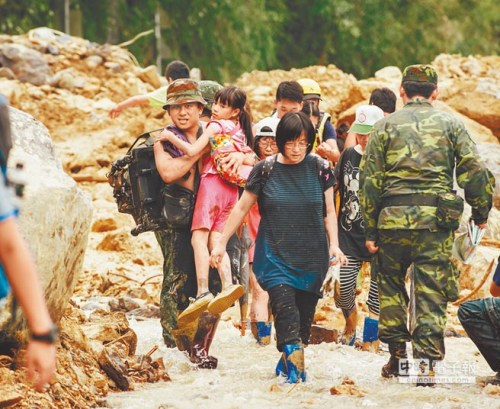 Soldiers assisting residents in Wulai, after landslides and other damage caused by Typhoon Soudelor in Taiwan.