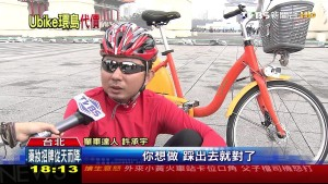 A cyclist being interviewed in Taipei after a round island trip on a Ubike