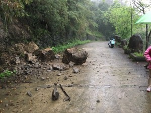 A rock-slide on a country road in Taiwan due to heavy rain