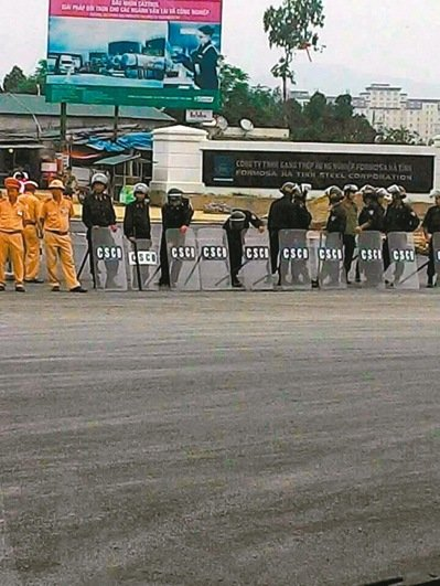 Riot police outside the gate of the Formosa Group steel mill in Ha Tinh Province Vietnam