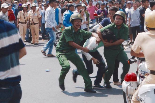 A protester is arrested in Vietnam