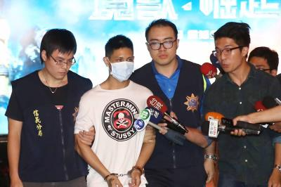 Zhou Jianshen is paraded before media after confessing to a brutal murder in Taipei City
