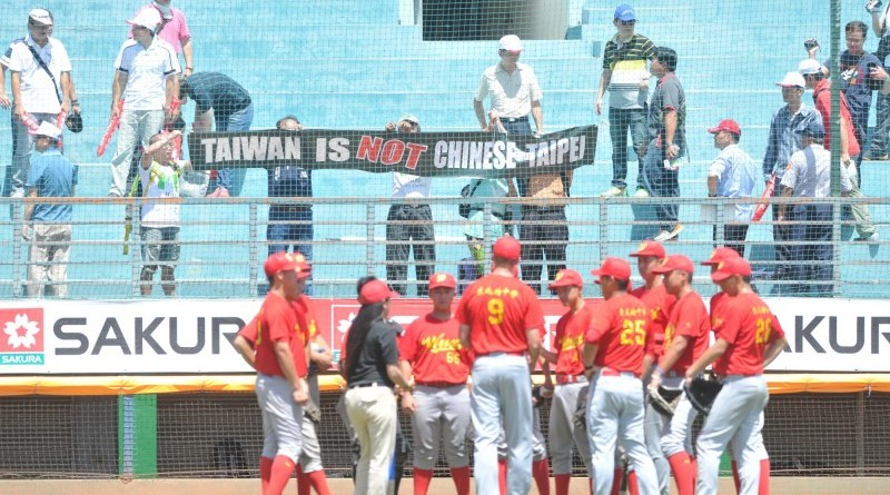 protesters hang a banner stating that Taiwan is not Chinese Taipei in front of the Chinese team at a match in Pingtung County