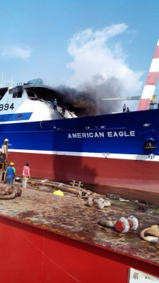Firefighters fight a blaze on the ship American Eagle