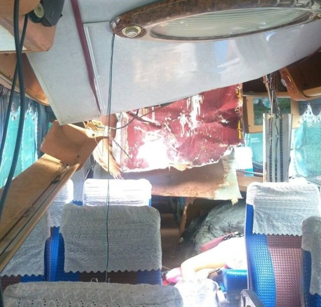 A boulder in a tourist coach after a rockslide in Taiwan