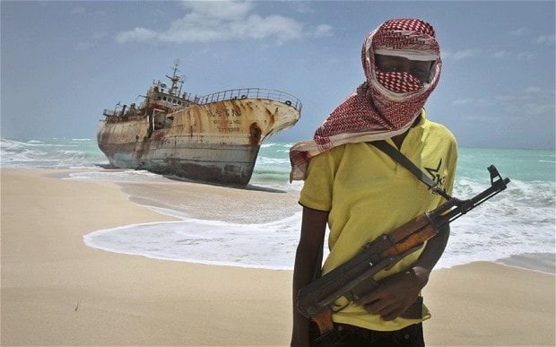 Somali pirate in front of Taiwanese fishing vessel