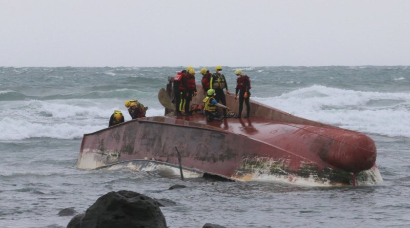 The overturned fishing vessel Jinrui yi number 88 is seen after drifting aground at Shimen in New Taipei City