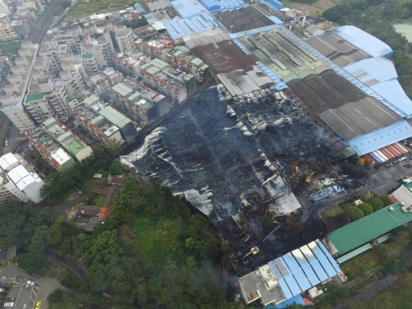 aerial view of tire factory yard after fire