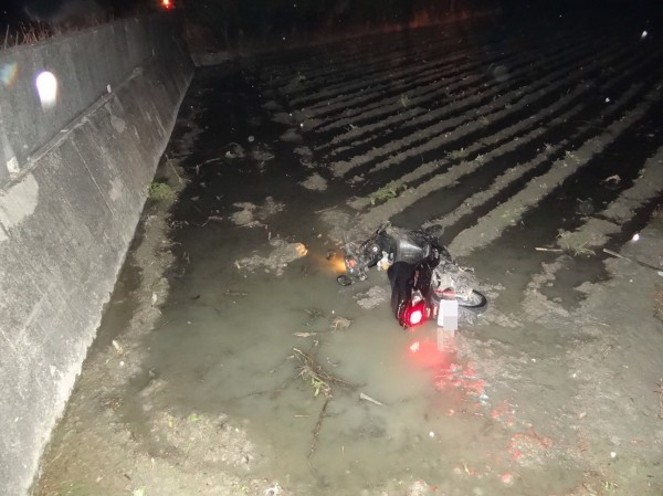 Scooter in rice paddy after accident