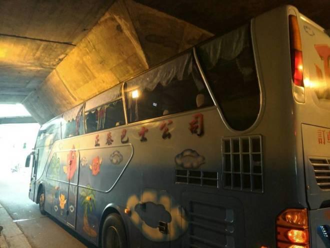 bus stuck in underpass