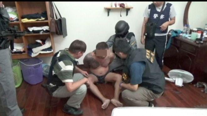 arrested ganster and swat team