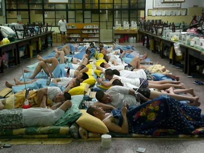 prisoners sleeping on the floor of an overcrowded prison in Taiwan
