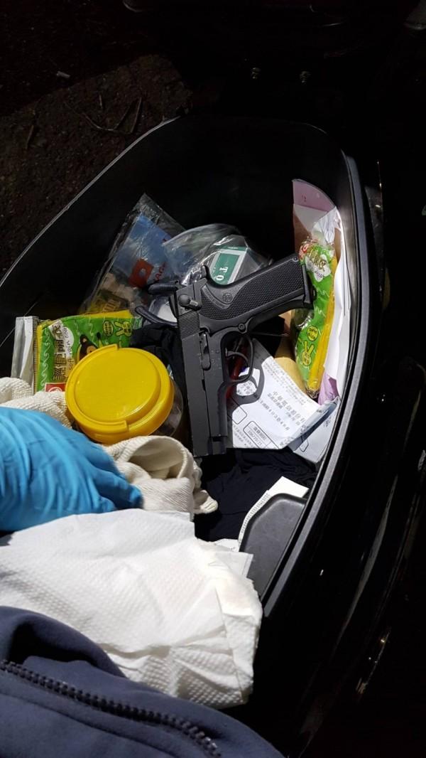handgun in scooter storage compartment