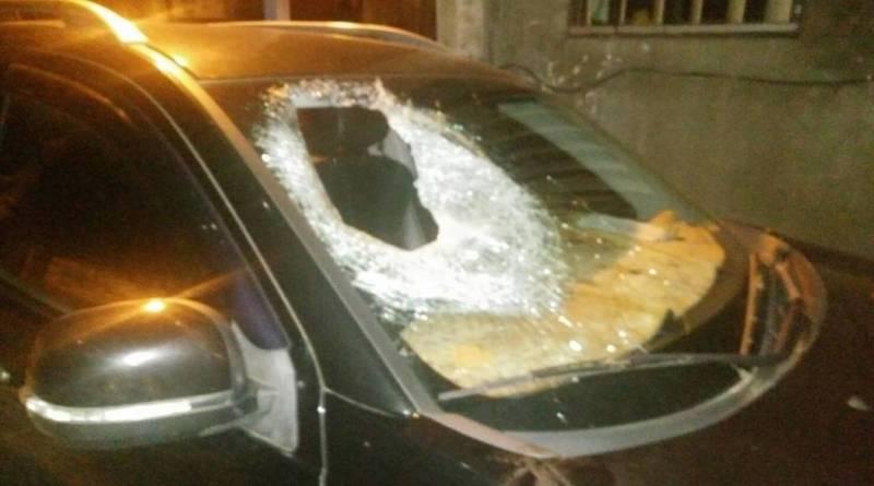 car damaged by falling rock