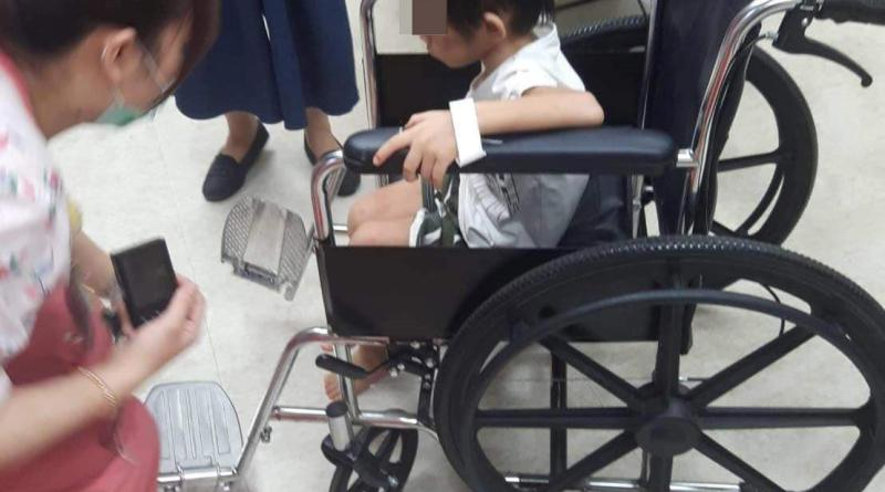 a boy in a wheelchair while in hospital for treatment and a check-up in child abuse case