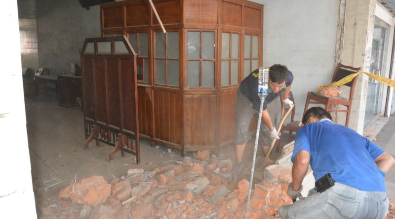 workers demolish a store front in Xinhua old street