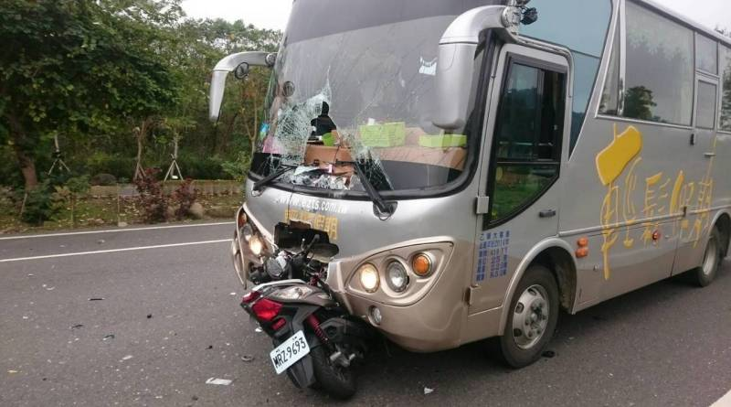 scooter and bus after crash