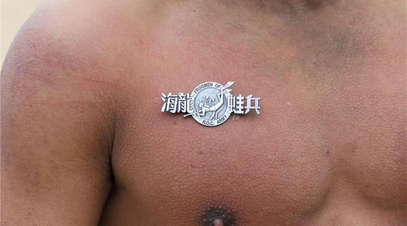 badge of Amphibious Reconnaissance unit pinned into flesh of chest