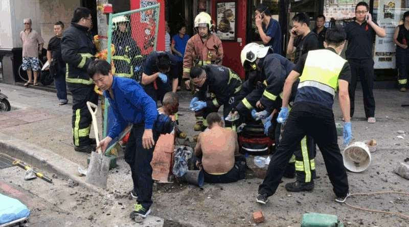 firefighters tend to injured workers at site of gas explosion