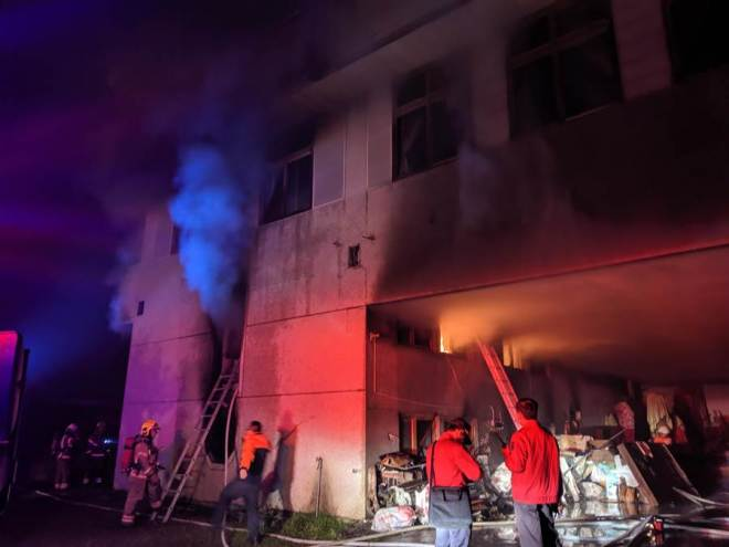 firefighters at the scene of a fire in Tainan City