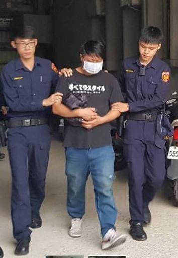 Mr Peng escorted by two police officers