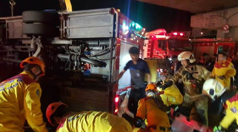 firefighters rescue colleagues after traffic accident in Kaohsiung City