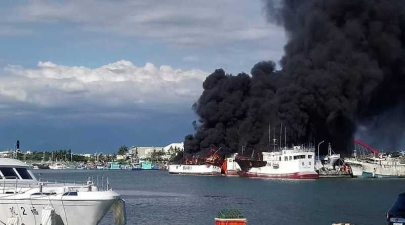 fishing vessels on fire at Yanpu Fishing Port in Pingtung County Taiwan