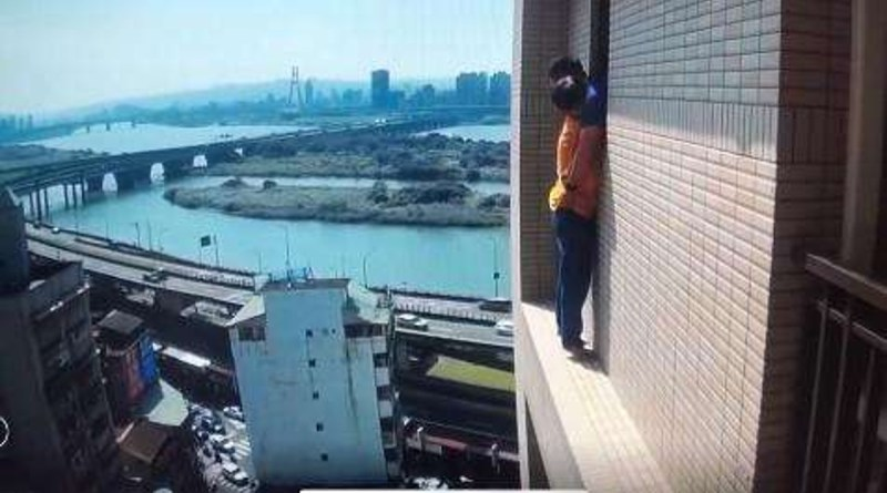 man on ledge on 14th floor