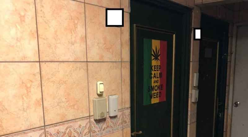 keep calm and smoke weed poster on apartment front door