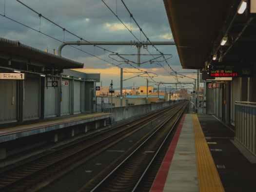 empty railway platform with rails