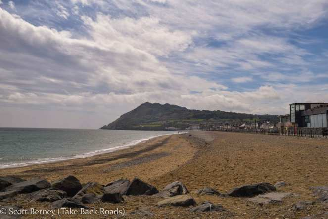 Beach Promenade at the start of the Cliff Walk from Bray to Greystones along the Atlantic Ocean south of Dublin Ireland. Sugarloaf Mountain stands on the horizon in the background.