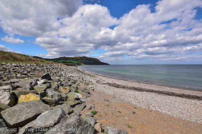 Greystones beach with Sugarloaf Mountain in the background under a beautiful blue sky