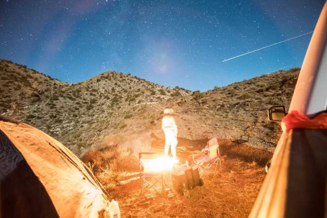 campfire campsite Mojave desert airplane trail