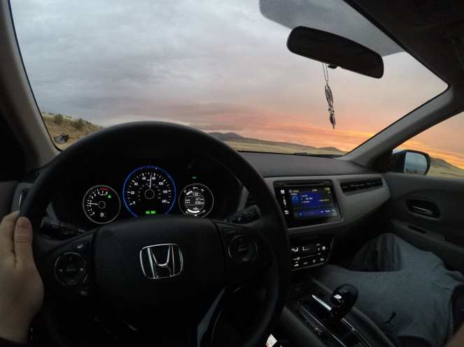 Driving Honda HR-V across the desert under a golden sunset