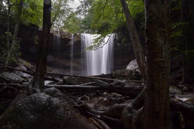 A dark and gloomy shot of Cucumber Falls from just downstream