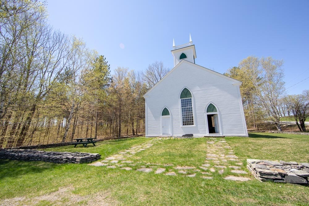 old white clapboard church meeting room on Old Canada Road National Scenic Byway in Maine