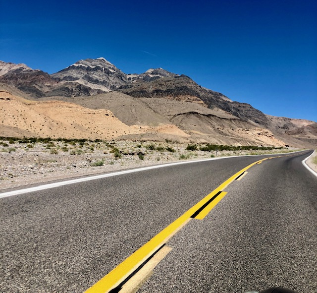 A gritty back road cuts through the desolate hills in Death Valley National Park, California