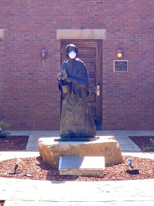 The Louisa Ann Swain statue in Laramie Wyoming wears a mask