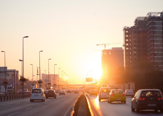 Cars driving on highway at sunrise